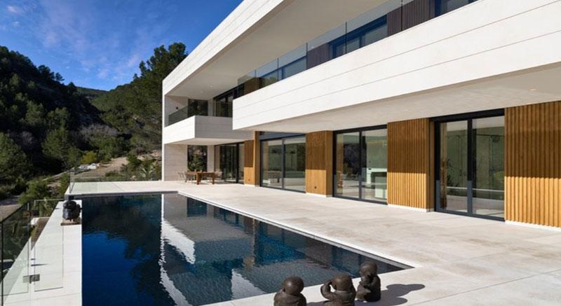 vivienda-otero-mallorca-son-vida-arquitecto-arkipolis-piscina-porche-piedra-madera